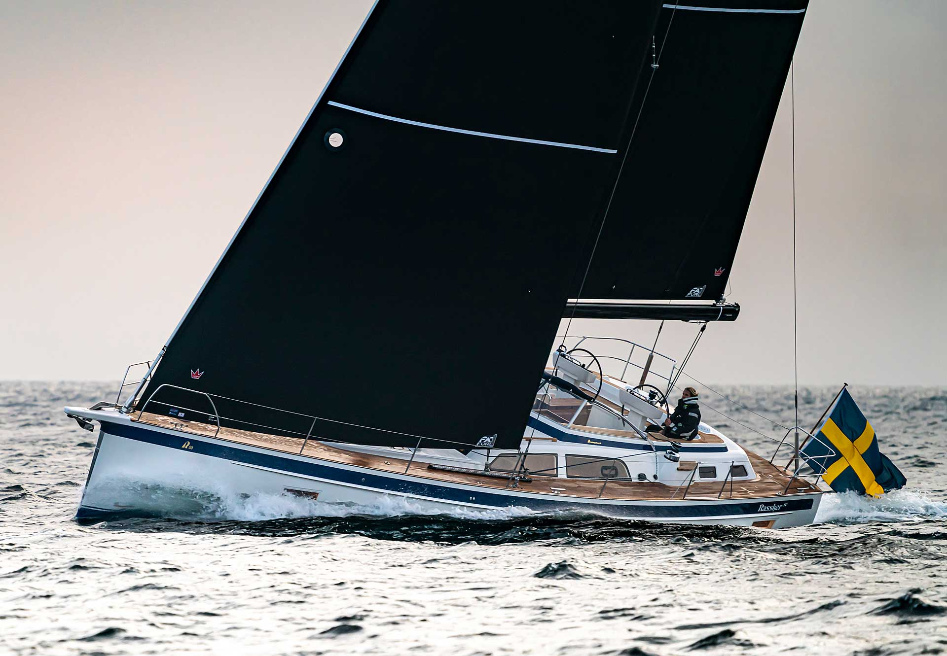 Exterior and sailing photos of the all-new Hallberg-Rassy 50